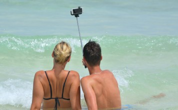 couple takes selfie beach