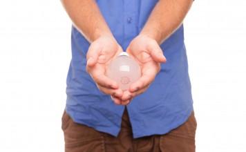 lightbulb held in hands